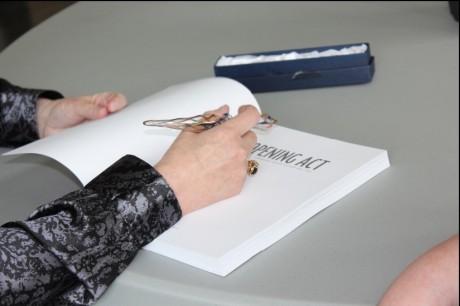 Susan signing a book